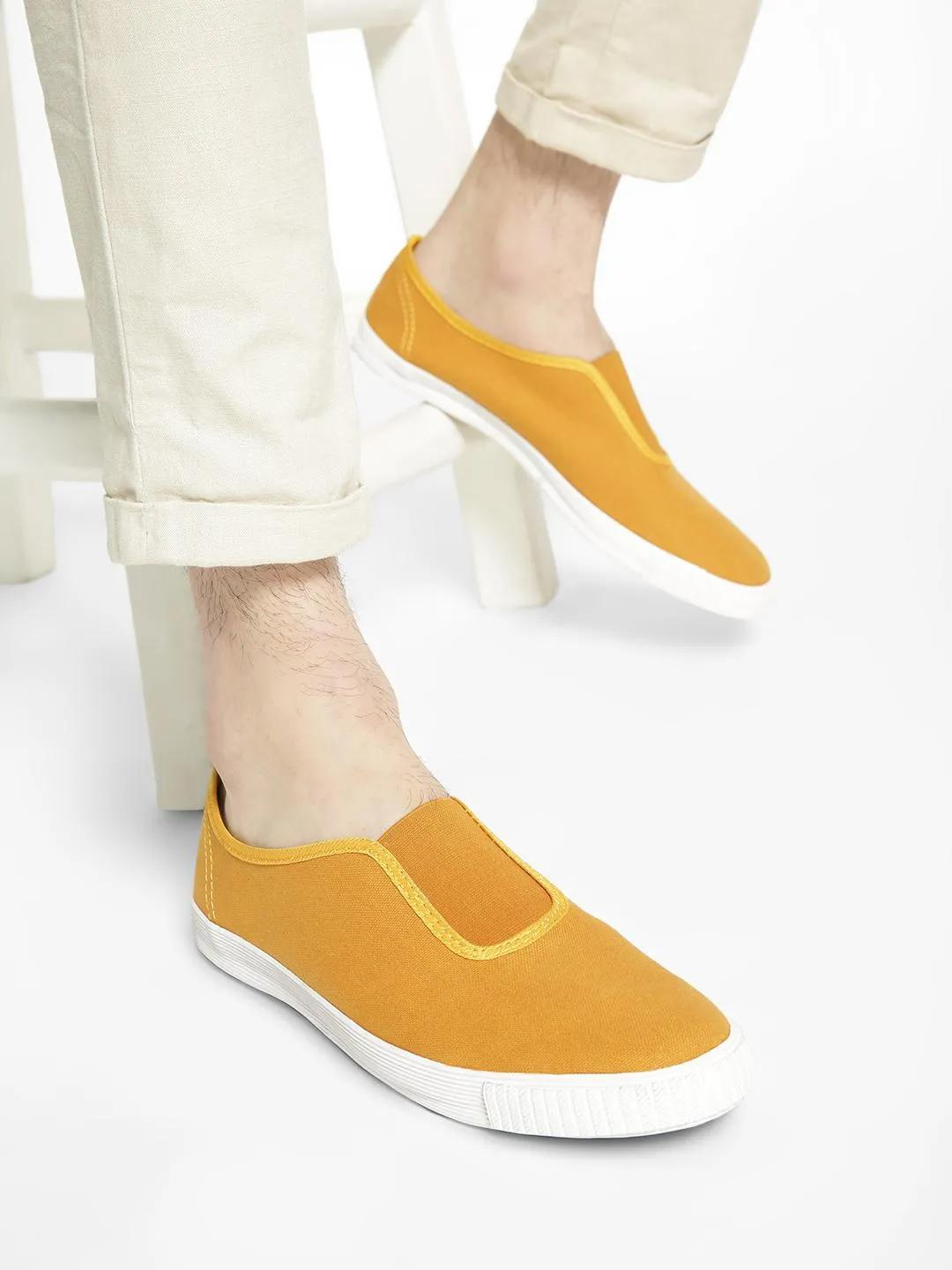 KOOVS Yellow Slip-On Gusset Plimsoll Shoes 1