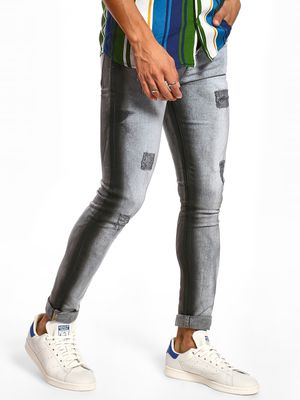 TRUE RUG Distressed Spray Paint Skinny Jeans