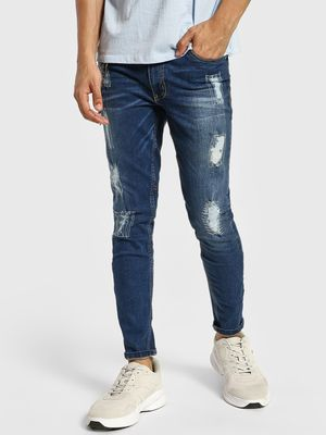 IMPACKT Distressed Light Wash Skinny Jeans