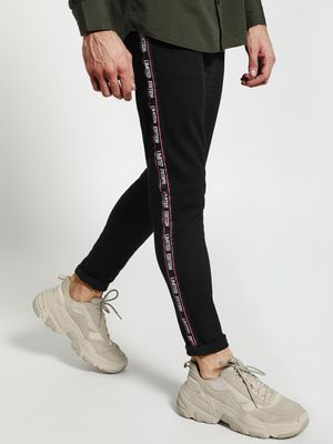 TRUE RUG Text Side Tape Slim Jeans