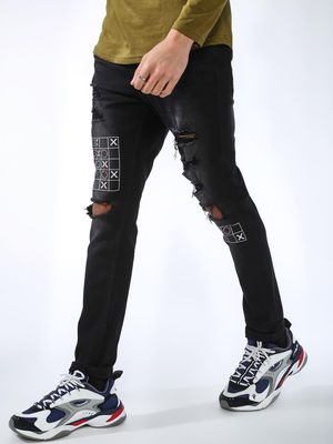 IMPACKT Ripped Tic Tac Toe Print Jeans
